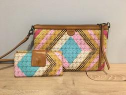 Fossil crossbody leather purse with matching wallet.