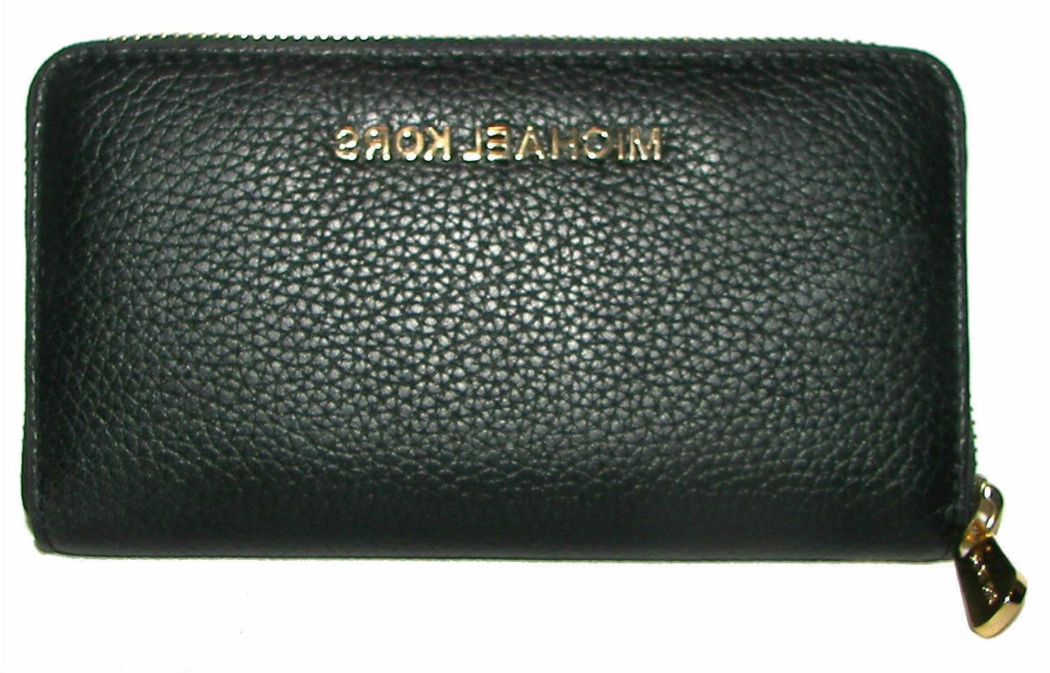 black leather tech zip around clutch wallet